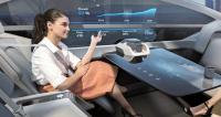 Vnitřní prostor autonomního konceptu Volvo 360c může mít mnoho podob. Jedna z nich může připomínat moderní kancelář s projekční plochou na boku
